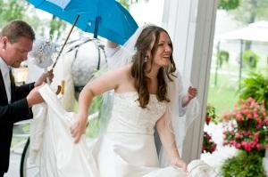 Such a happy couple depsite a torrential downpour!